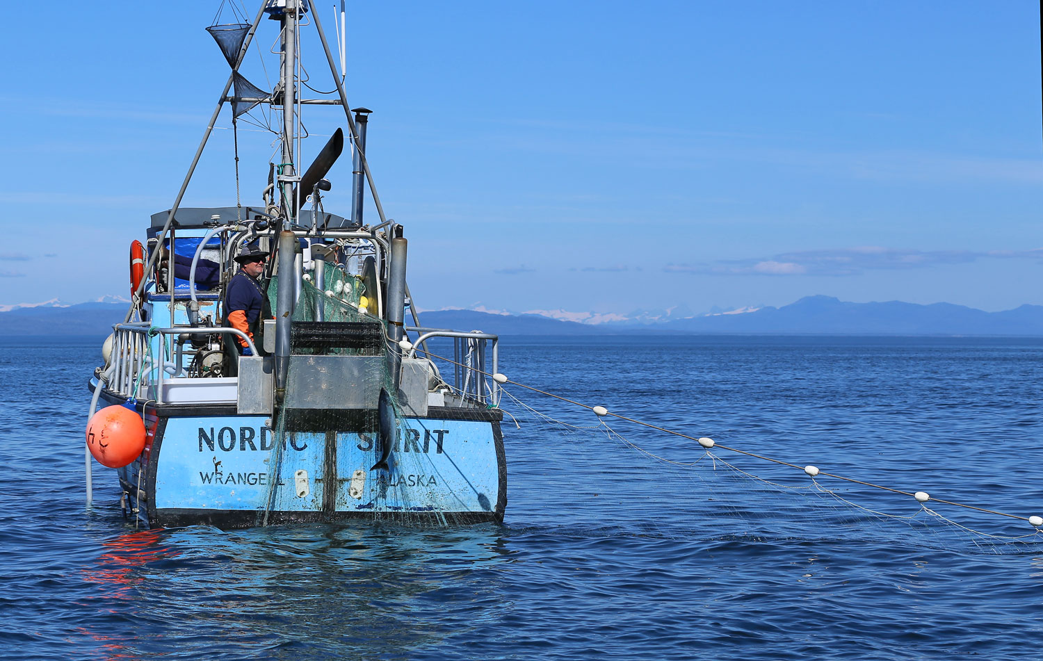 "The gillnetter ""Nordic Spirit"" bringing in a nice silver salmon in Sumner Strait."