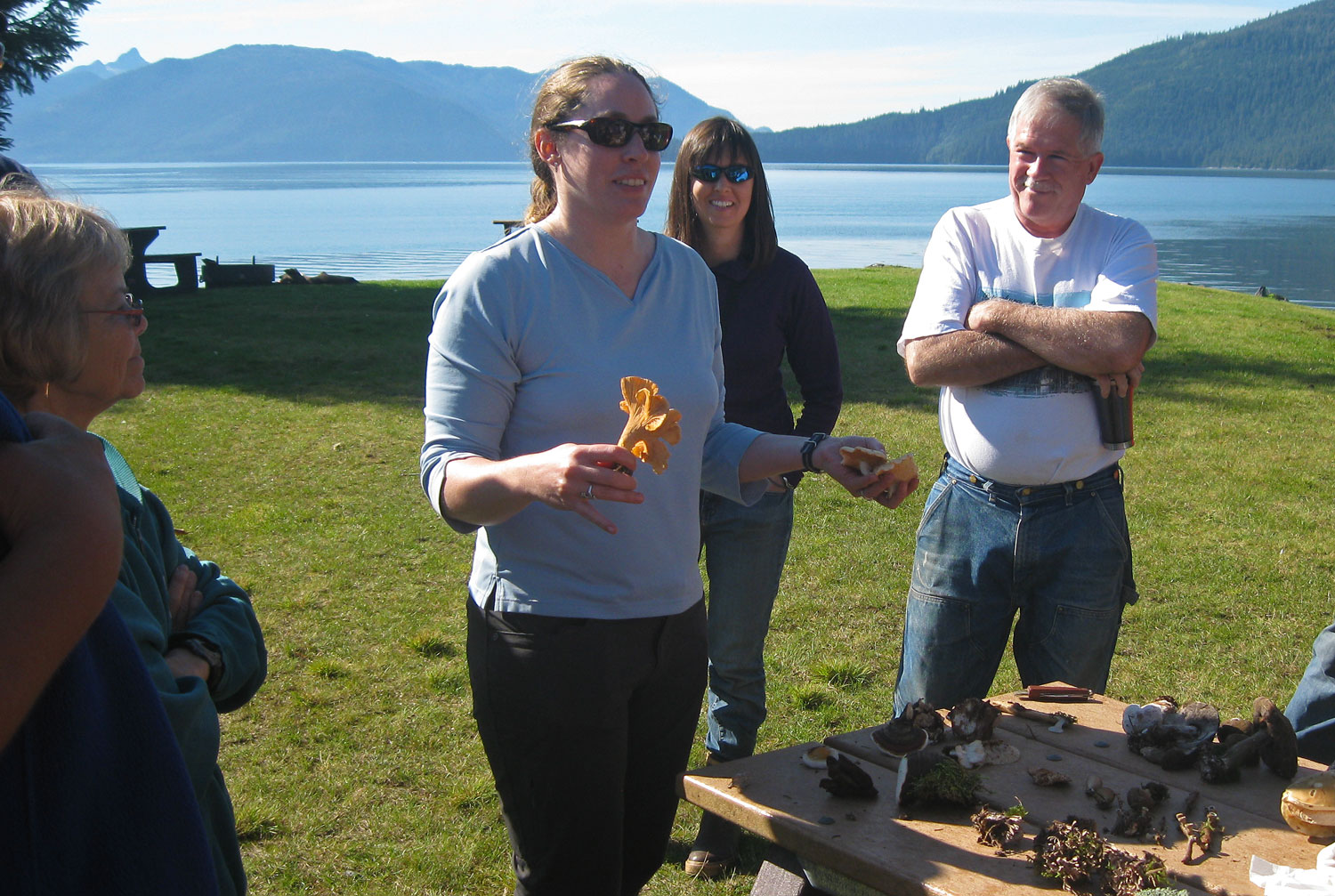 Kate Mohatt discussing the merits of golden chanterelles  and hedgehog mushrooms for dinner.
