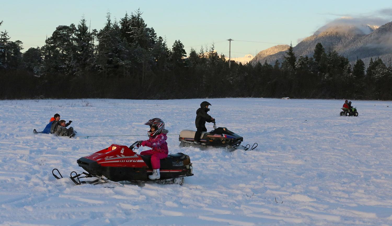 Kids snow snowmobiling sledding Southeast Alaska
