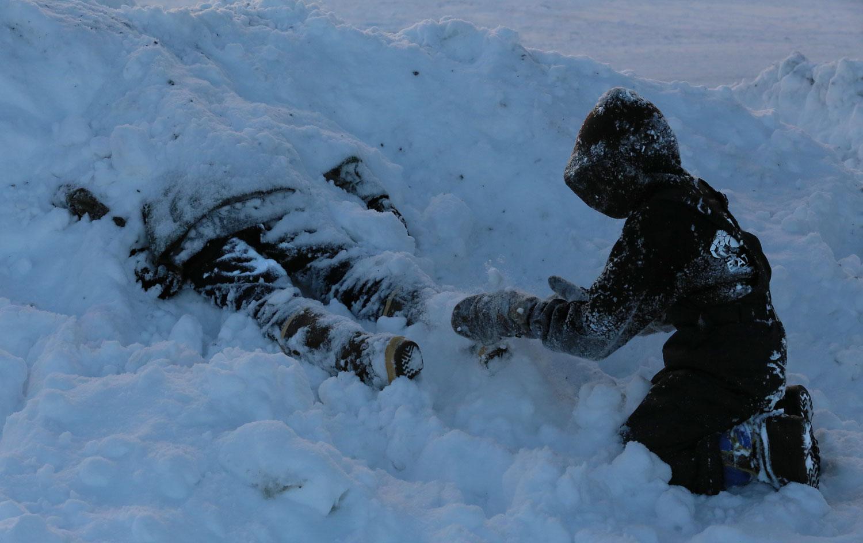 Kids snow bury Southeast Alaska