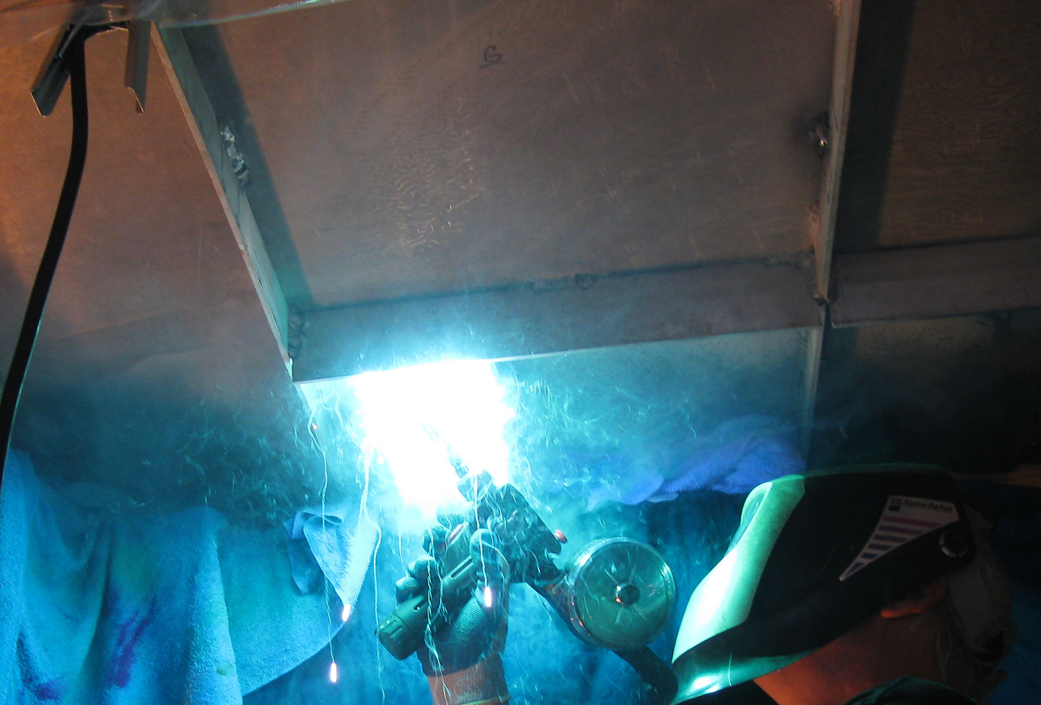 Welding reinforcing plates and angles under the deck supporting the anchor winch.