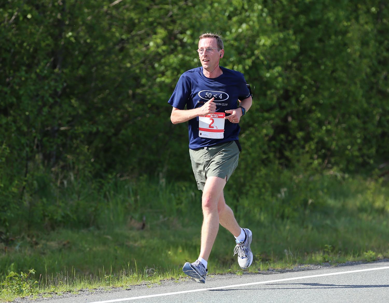 Steve Miller flying through the POW Marathon.