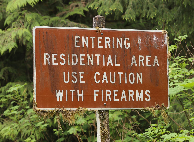 sign Alaska guns firearms posted funny