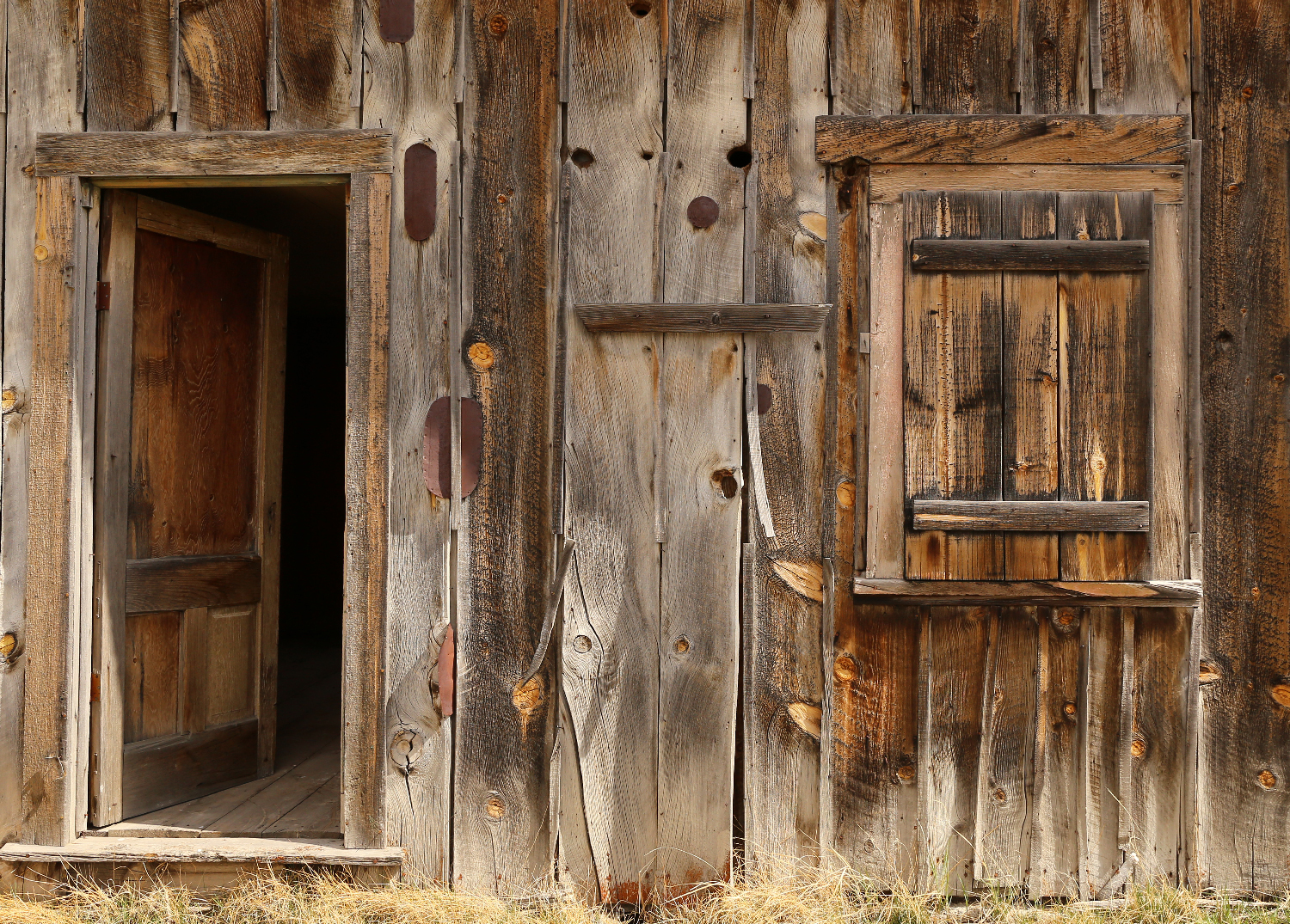 weathered pine boards metal patches wall window door old farmhouse