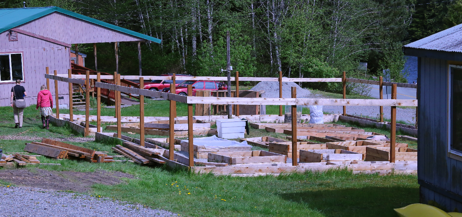 """The Hollis school """"Math Garden"""" under construction. Within the forms of the raised beds there are X and Y axes and geometric forms. The students and staff will grow fresh food for the school lunch program."""
