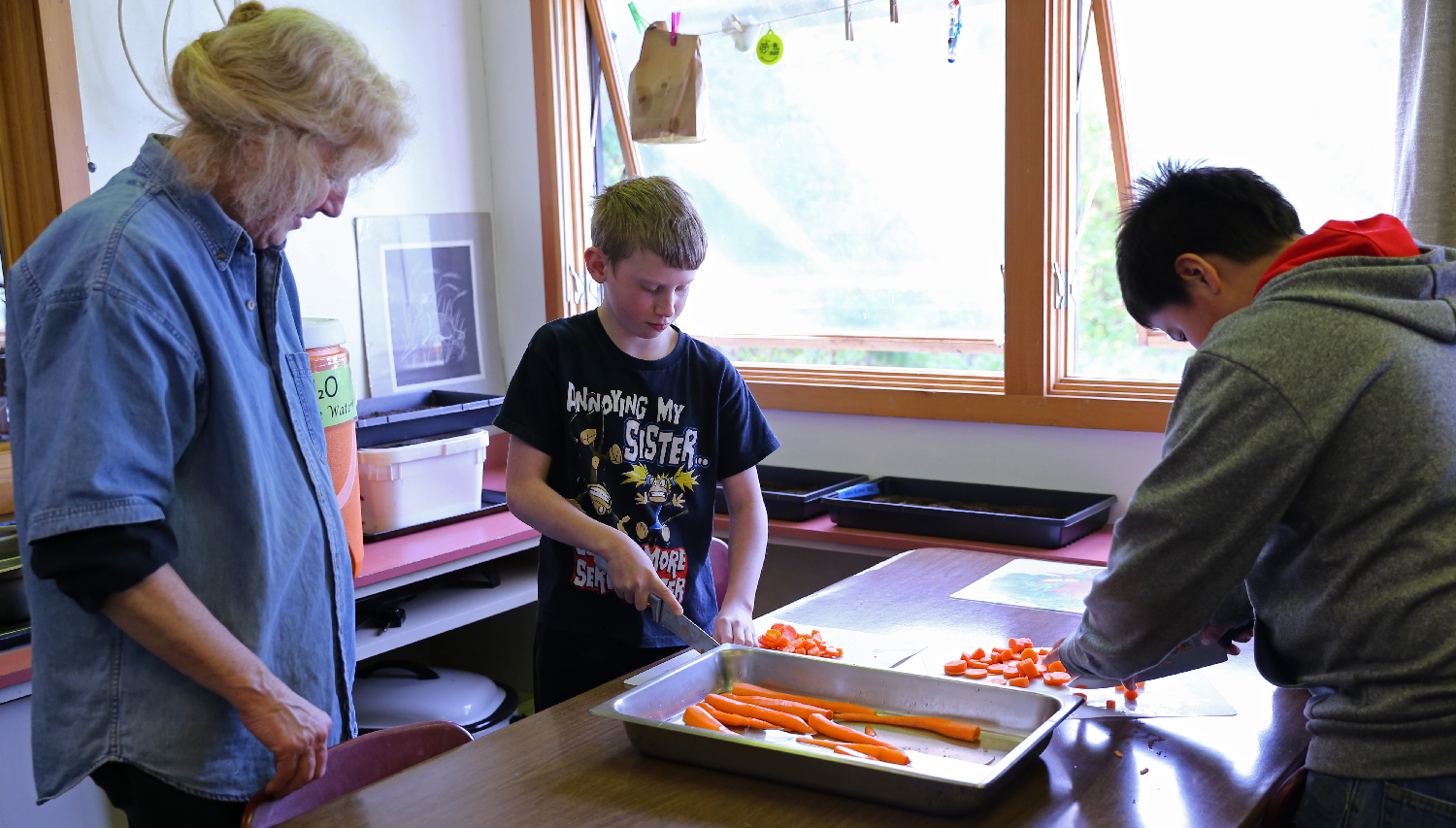 The intermediate and high school students, all boys, got lots of practice with knives on this day. Cathy visits with Ben and Myles while they cut up carrots for pickling. Cathy cooks breakfast and lunch for the students, keeps the place clean, and is a calm and wise presence.
