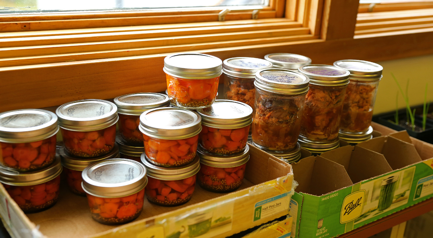 Pickled carrots and canned smoked salmon put up by the students. This bounty will be enjoyed by the students and guests at special school events.