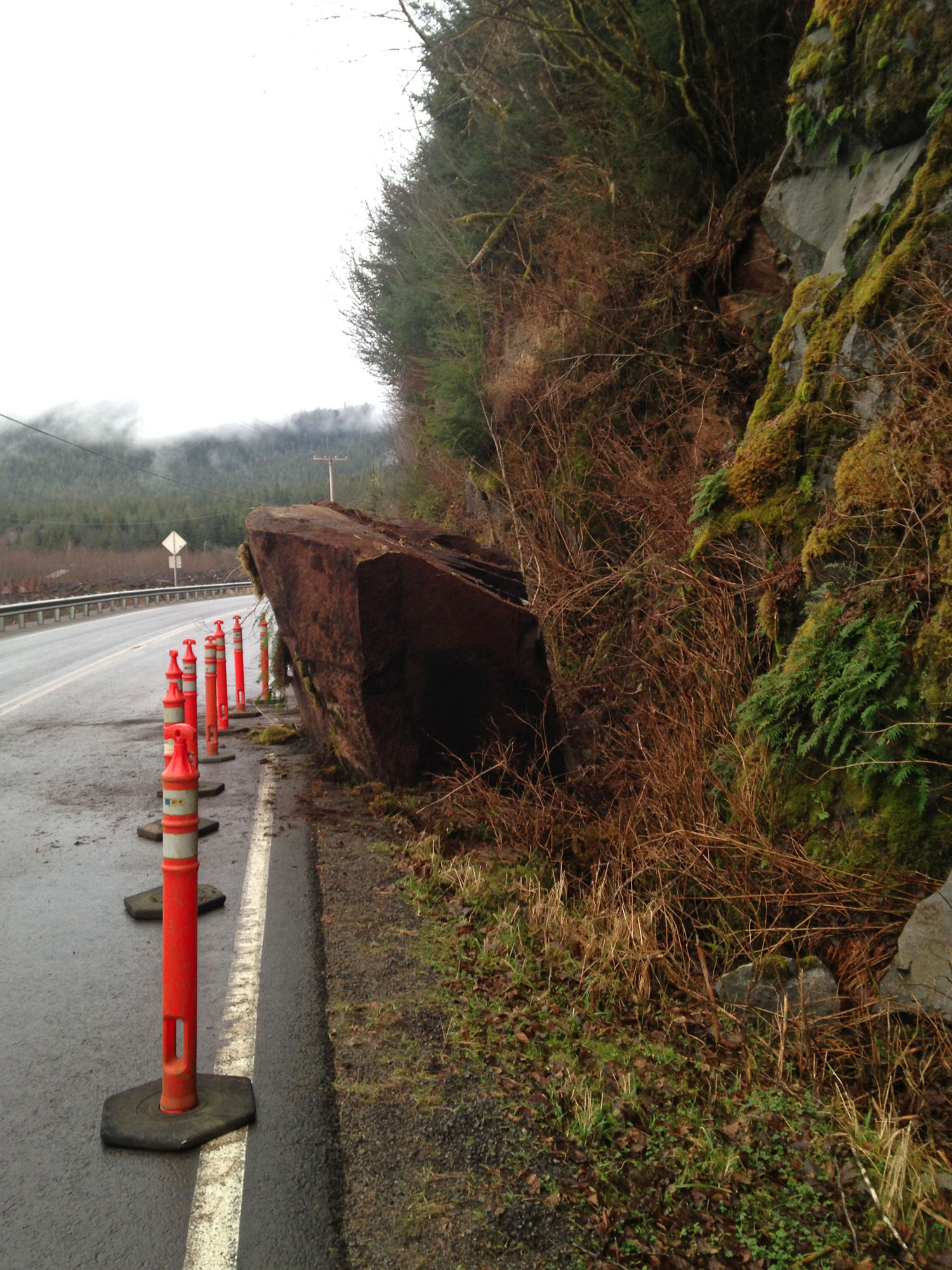 Huge rock on road fell from cliff giant stone huge rock