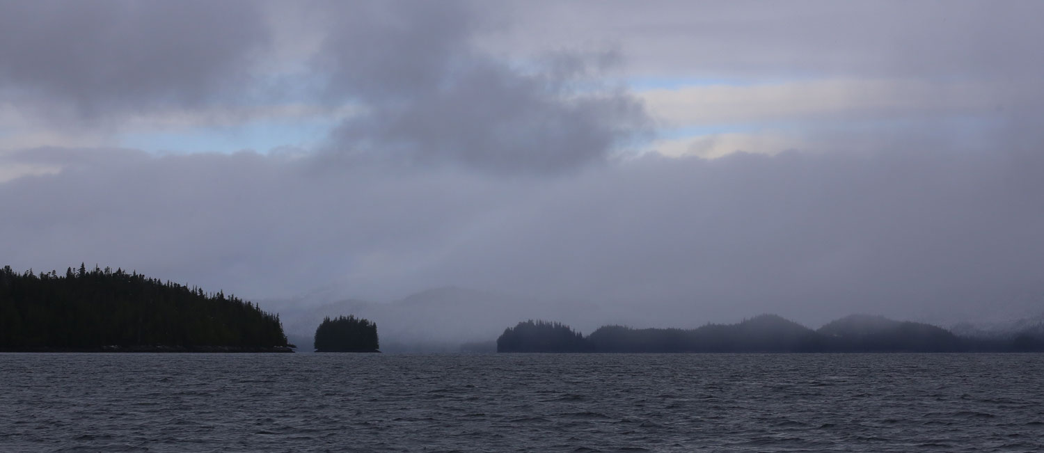 Fog and overcast breaking up in Southeast Alaska islands