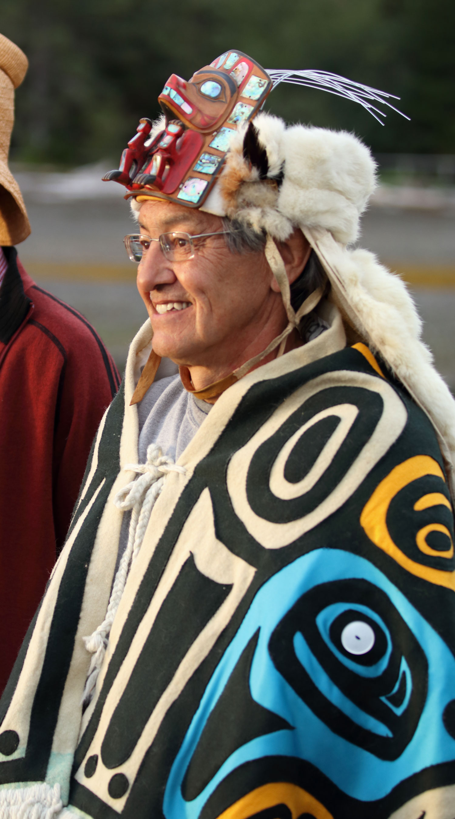Chief Son-I-Hat John McAllister greeting arriving visitors.