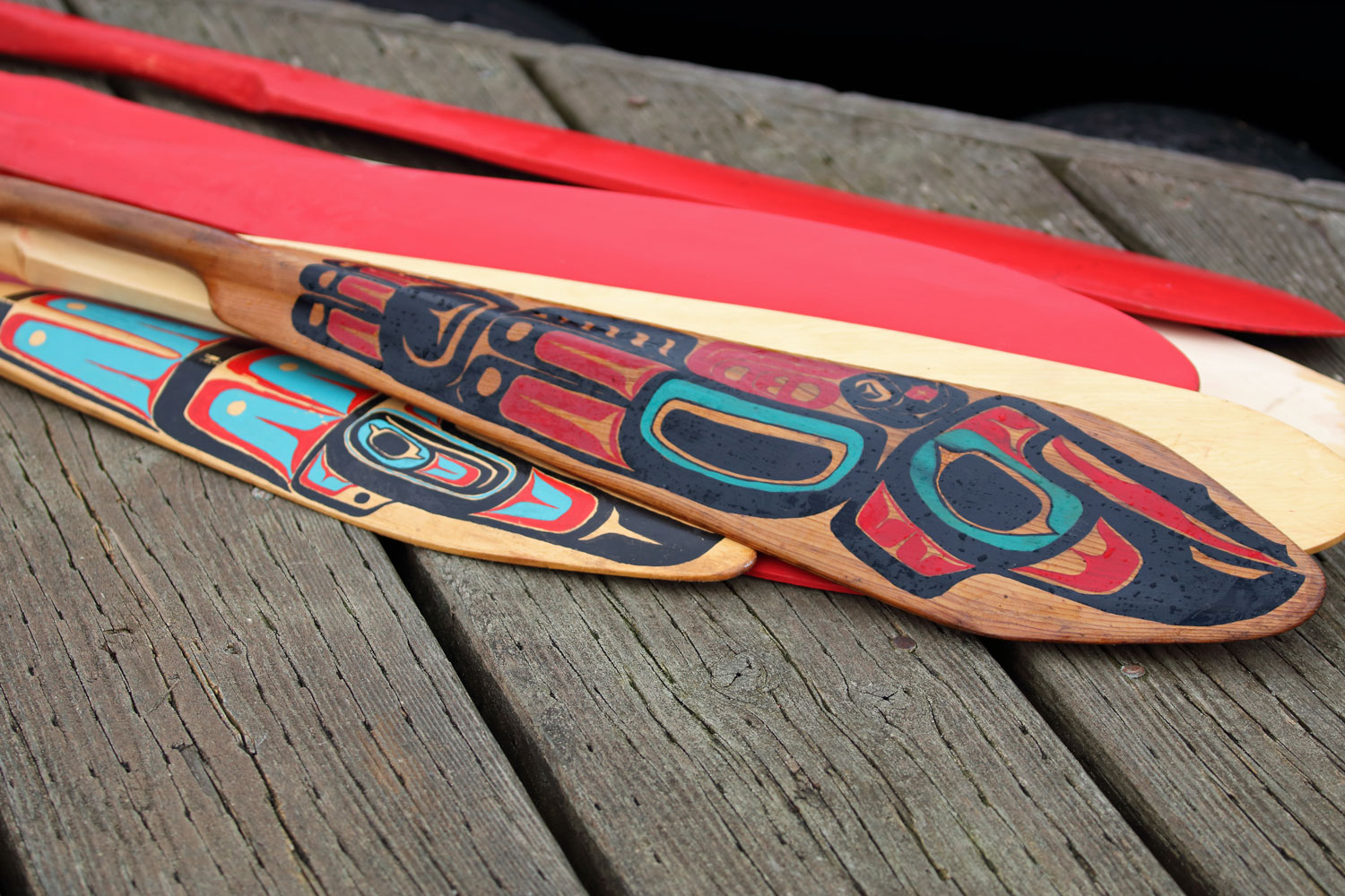 Hand painted canoe paddles on the dock at the harbor.