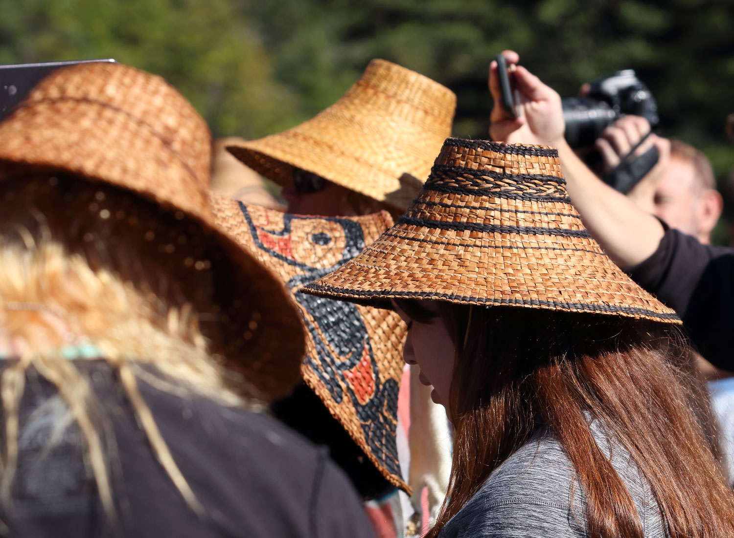 Cedar bark hats (and cell phones taking photos) were everywhere!