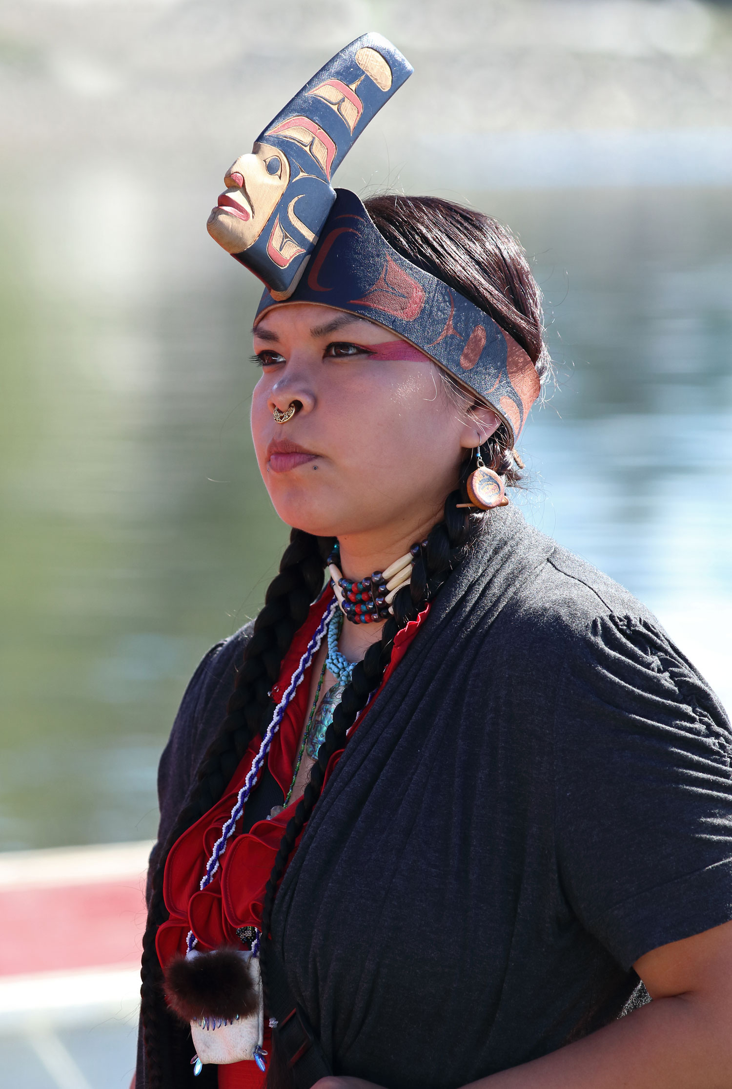 This beautiful Haida woman stood by the canoe that she helped paddle to the ceremony in Kasaan.