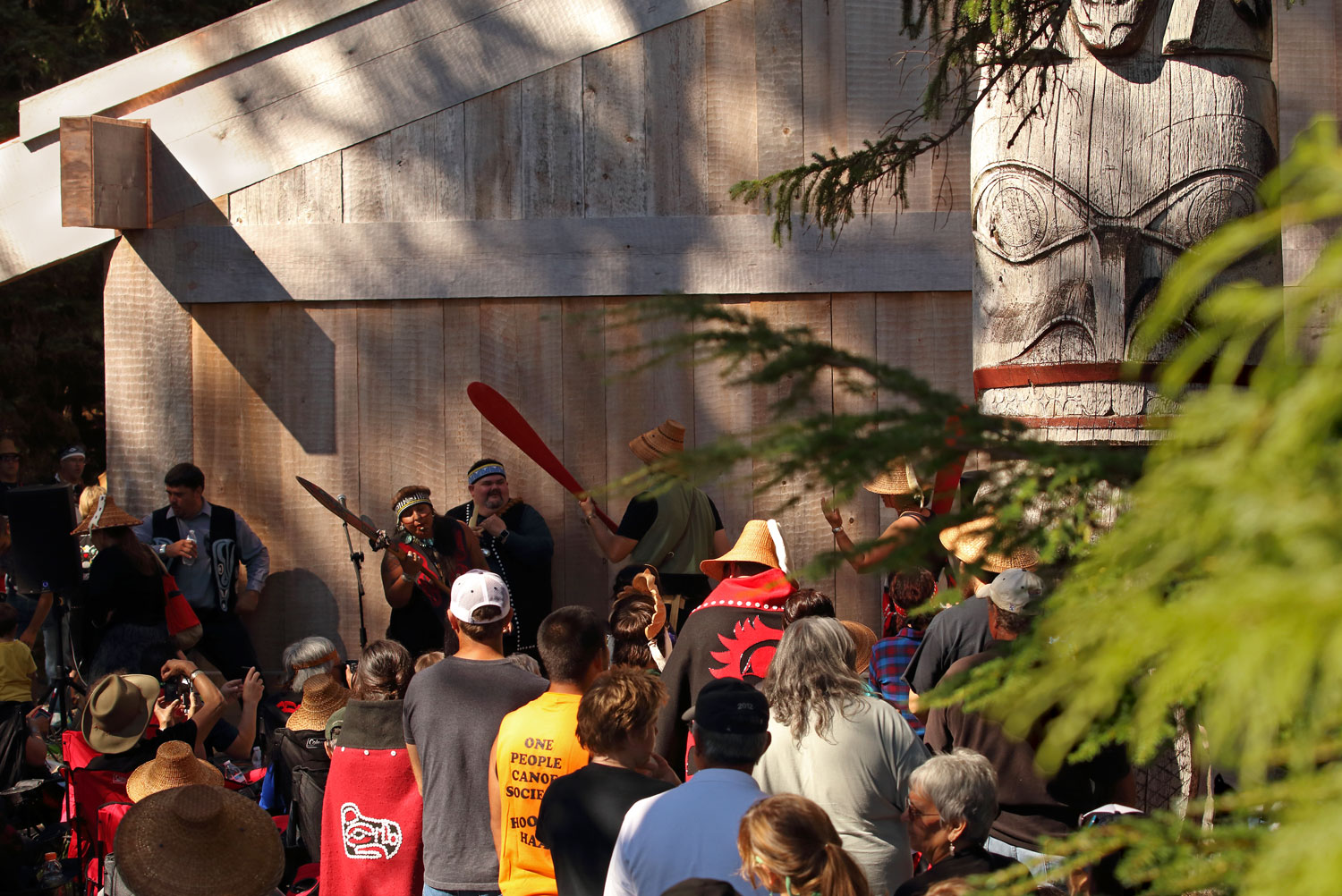The Haida dancers sang and drummed as they danced their way around the longhouse.