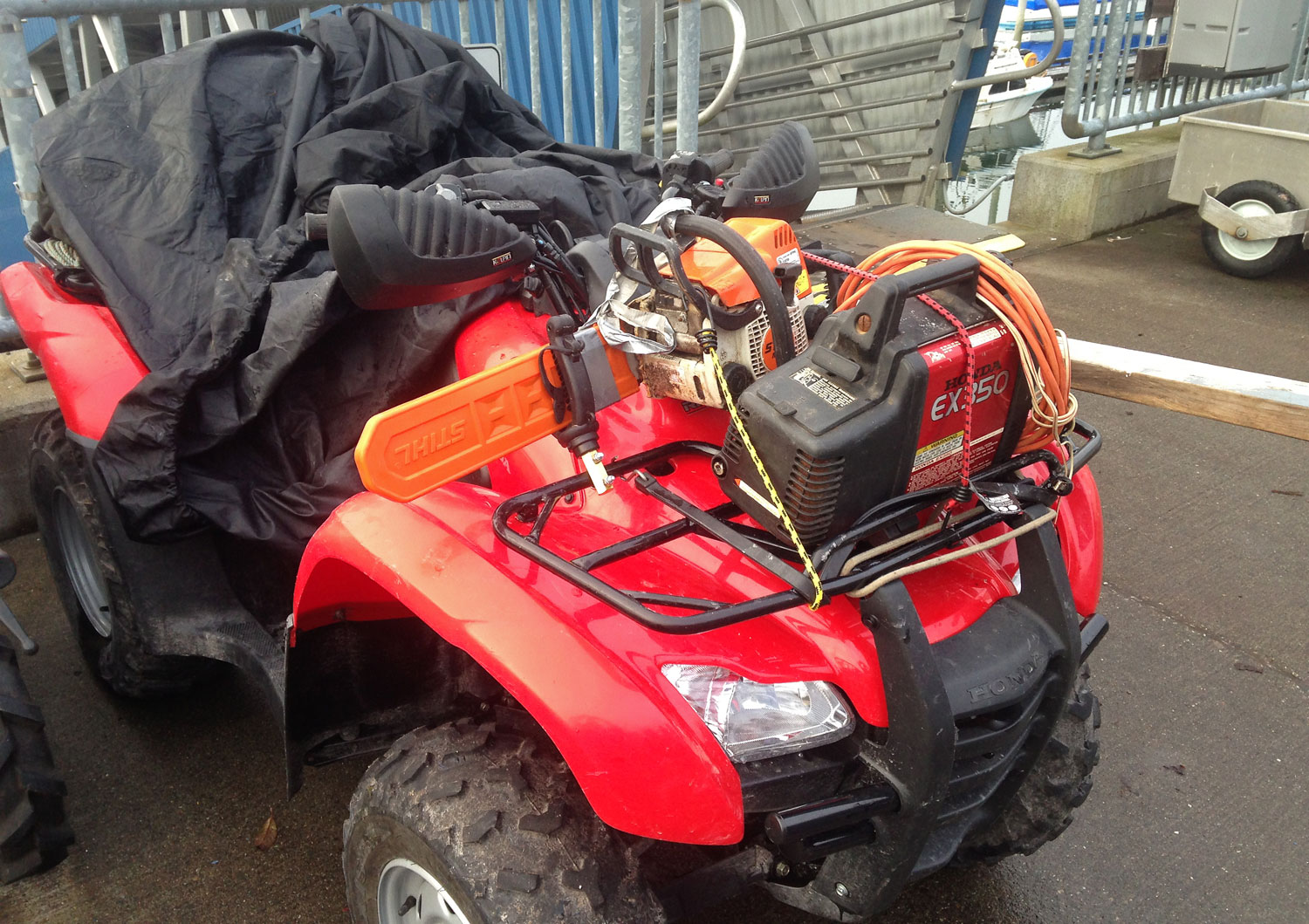 Four wheeler ATV with chainsaw and generator