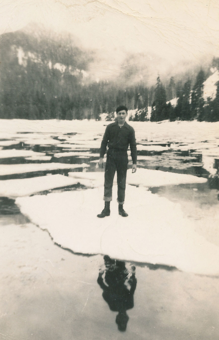 Chuck standing on an ice cake Hood Bay Admiralty Island winter 1950