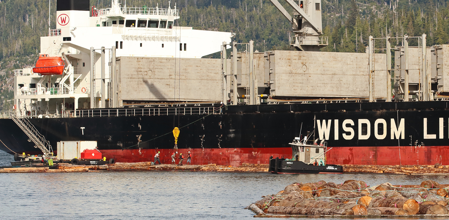 Slinging a log bundle while loading logs onto a cargo ship at Prince of Wales Island in Southeast Alaska
