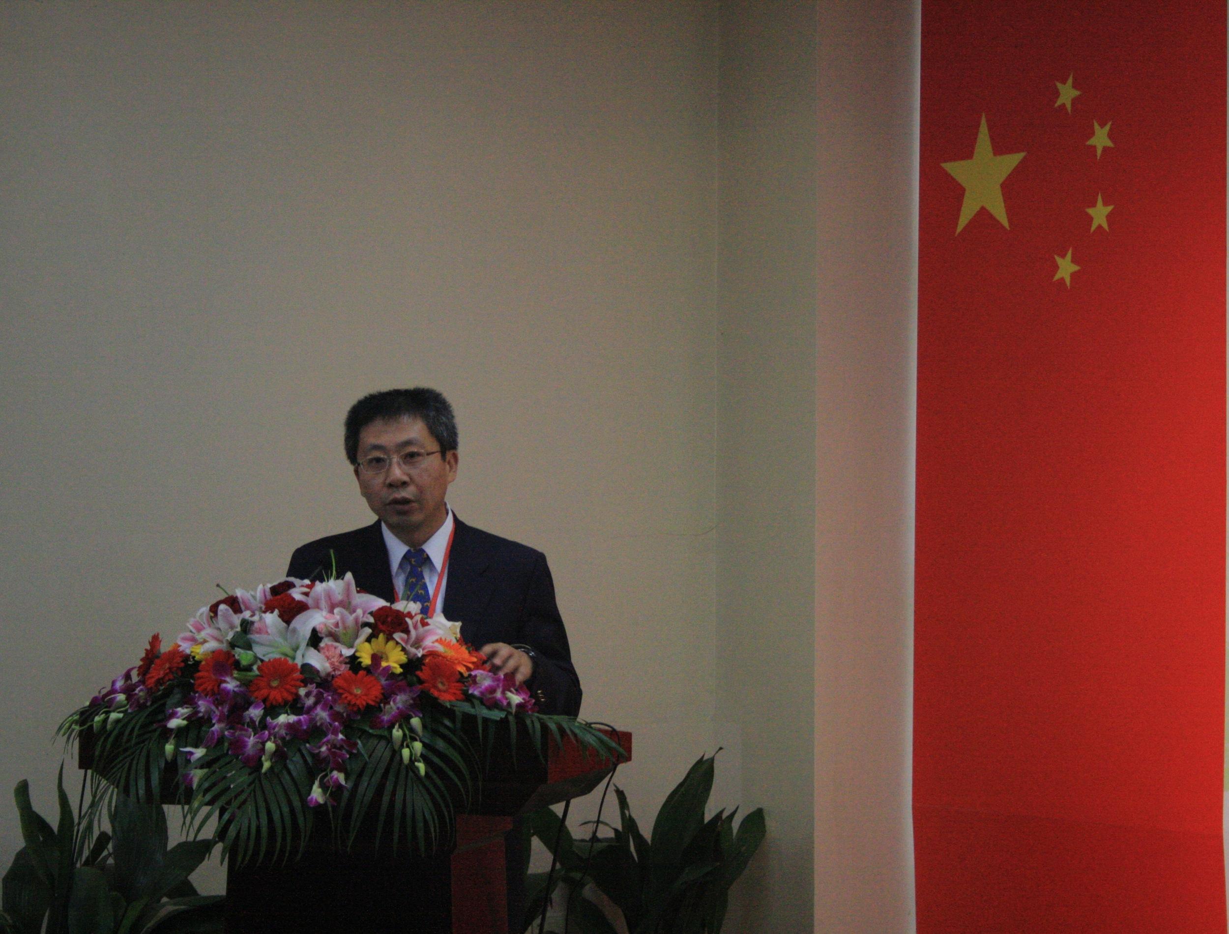 Prof. Yang YE, Deputy Director of SIMM, is giving the opening speech.