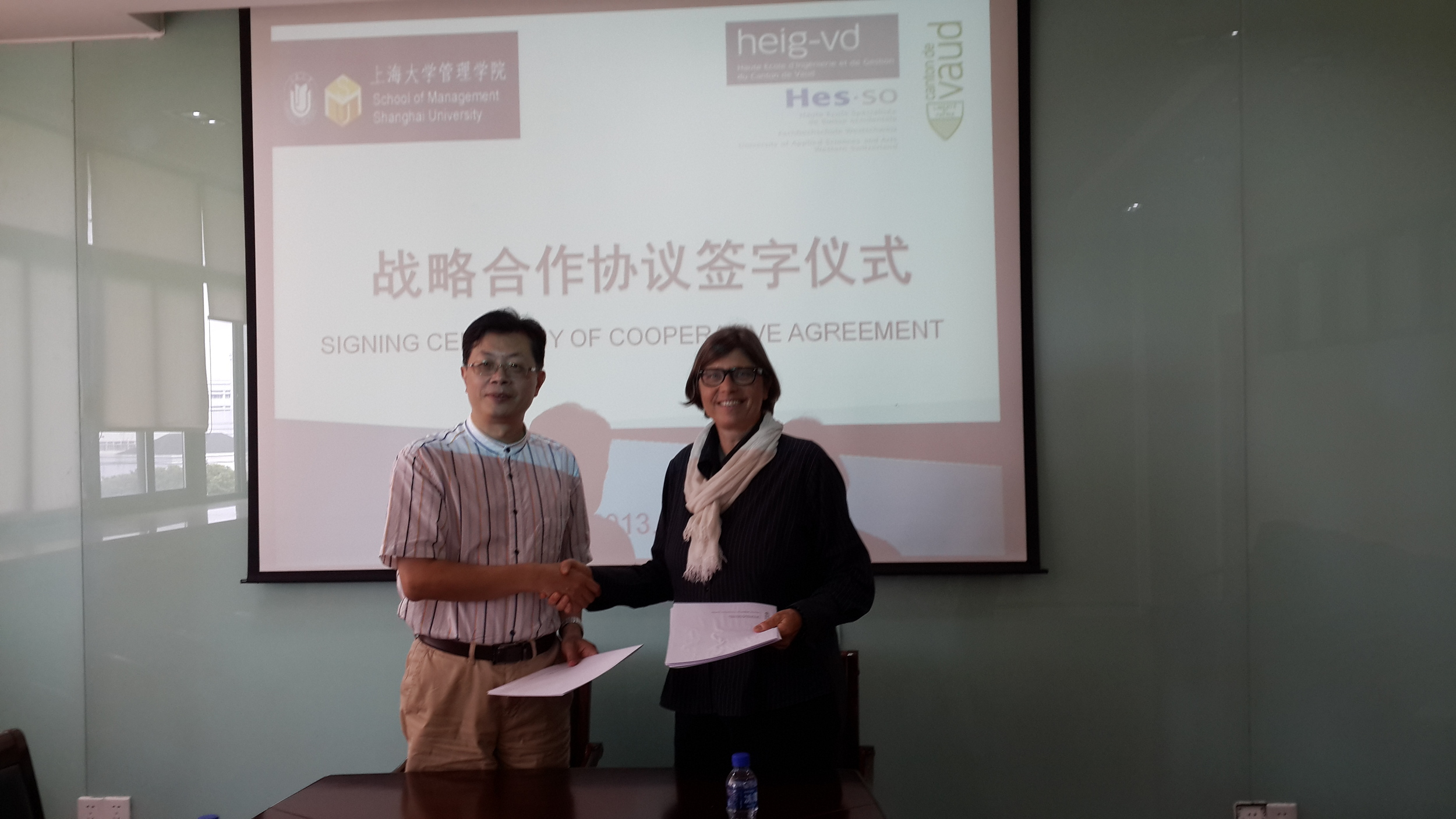 Ms. Maxline Stettler, the Director of International Affairs, Board of Higher Education, Canton of Vaud in Shanghai University, signing cooperative agreement