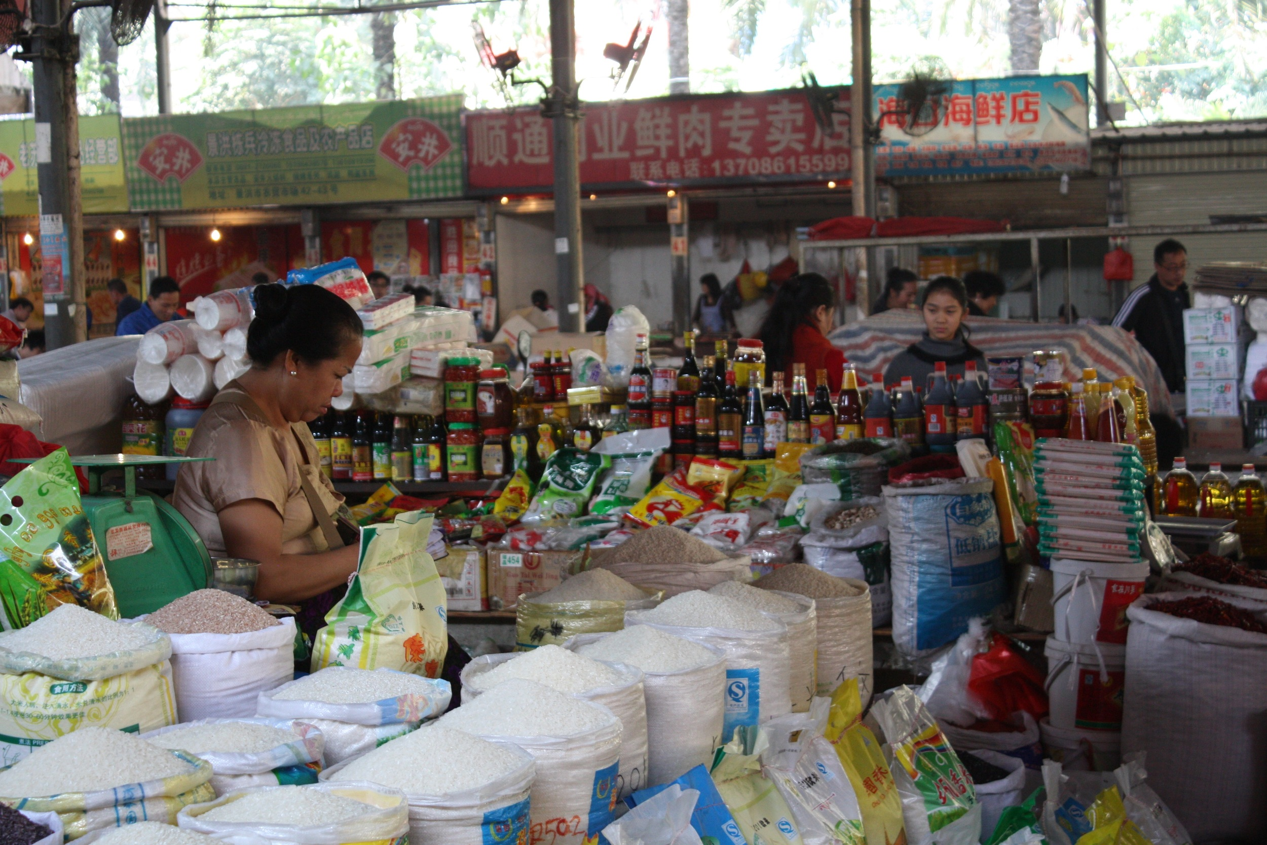 Dai woman selling rice in a market in Xishuangbanna