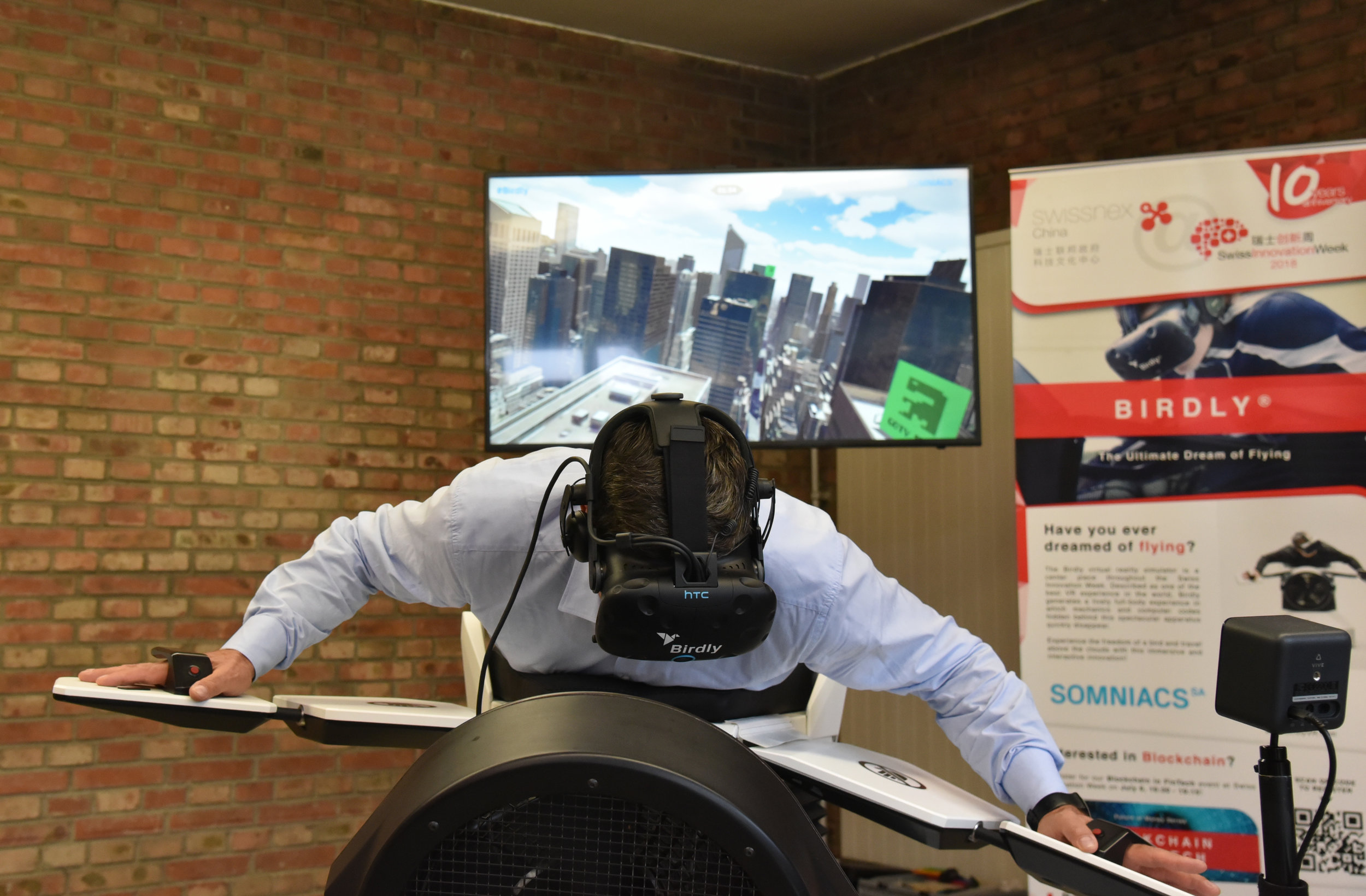 State Secretary of Switzerland Dr. Mauro Dell' Ambrogio trying out the Birdly®VR flight simulator.