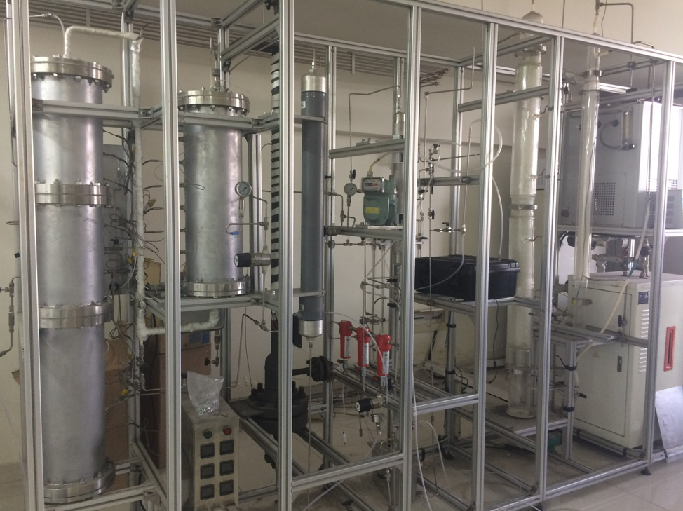 Image: Lab setup at SJTU, Jiao Tong University, demonstrating three different mechanics of isolating CO2 form emission stream. The valve is our collection was part of this complicated setup that the PhD students were putting together.