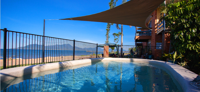 Keep cool in the Cardwell Beachfront Motel pool while gazing out to the Coral Sea.