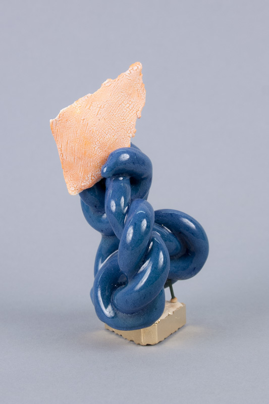 Genie , 2013  Glazed ceramic, gold leaf, kiln stilt  4.5 x 2.5 x 3 inches