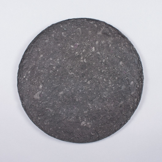 Moon (A New Turn) , 2013  Cast paper pulp made of discarded artworks  12 inch diameter