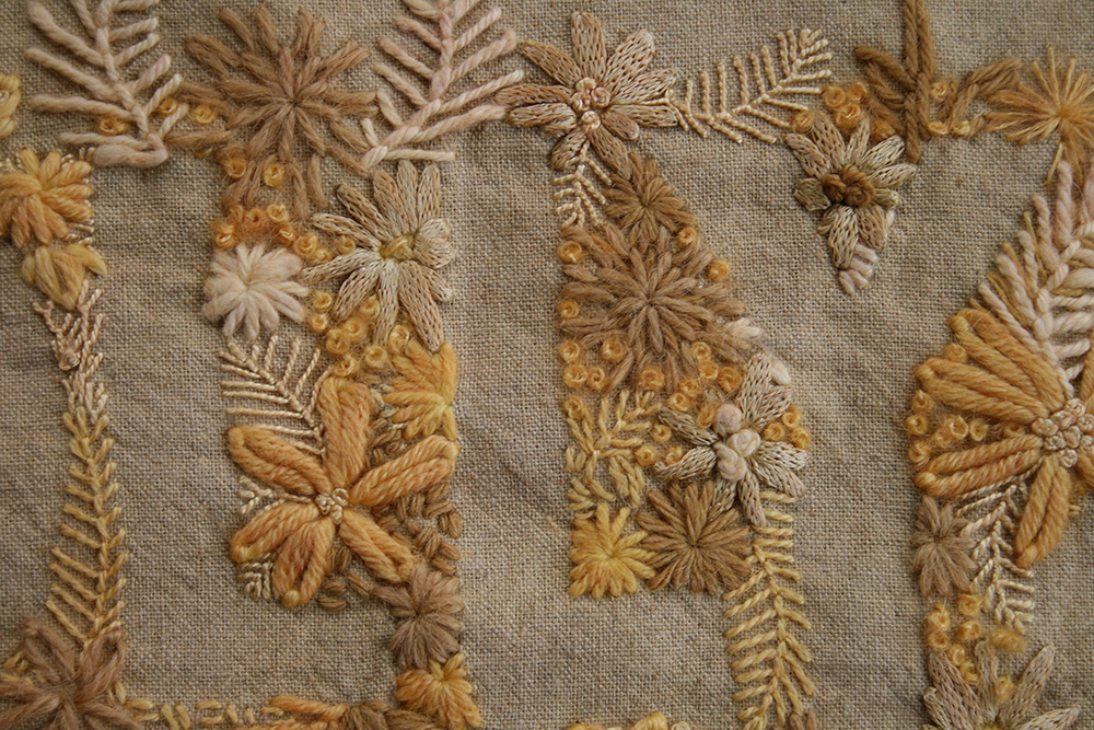 A detail shot of one embroidery dyed in Dyers Chamomile with an Alum Mordant.