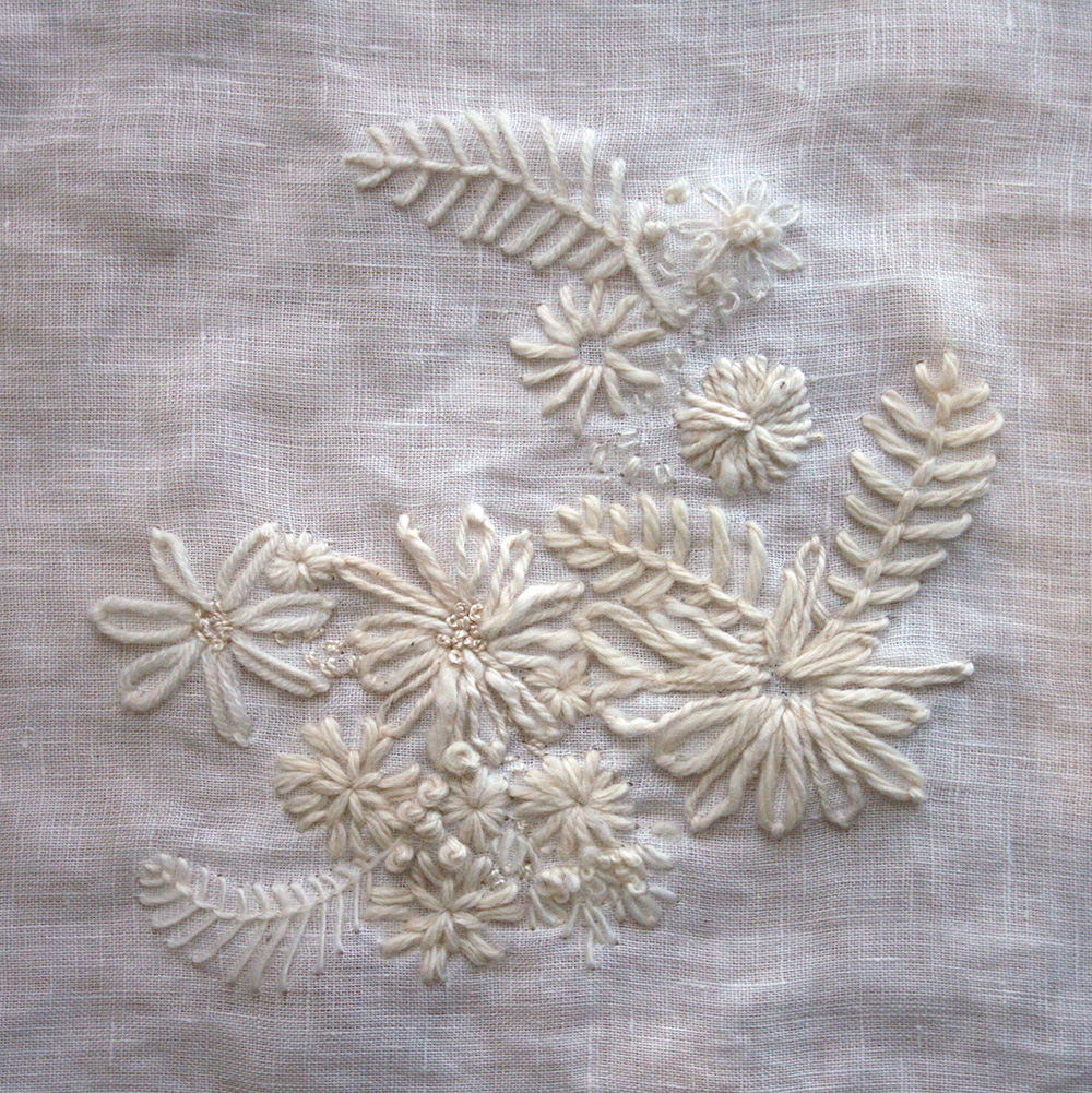Sampler 2 - a variety of all white yarns stitched onto a fine white 100% linen.