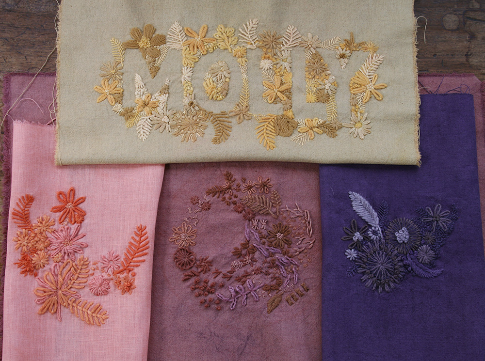 All of the finished embroideries after dyeing, drying and being pressed!