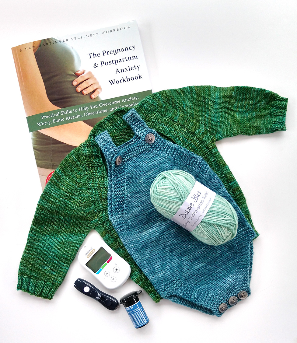 Blood sugar tracking equipment, an anxiety workbook especially for pregnant ladies (I highly recommend by the way!), and one of my coping techniques: knitting things for the baby!