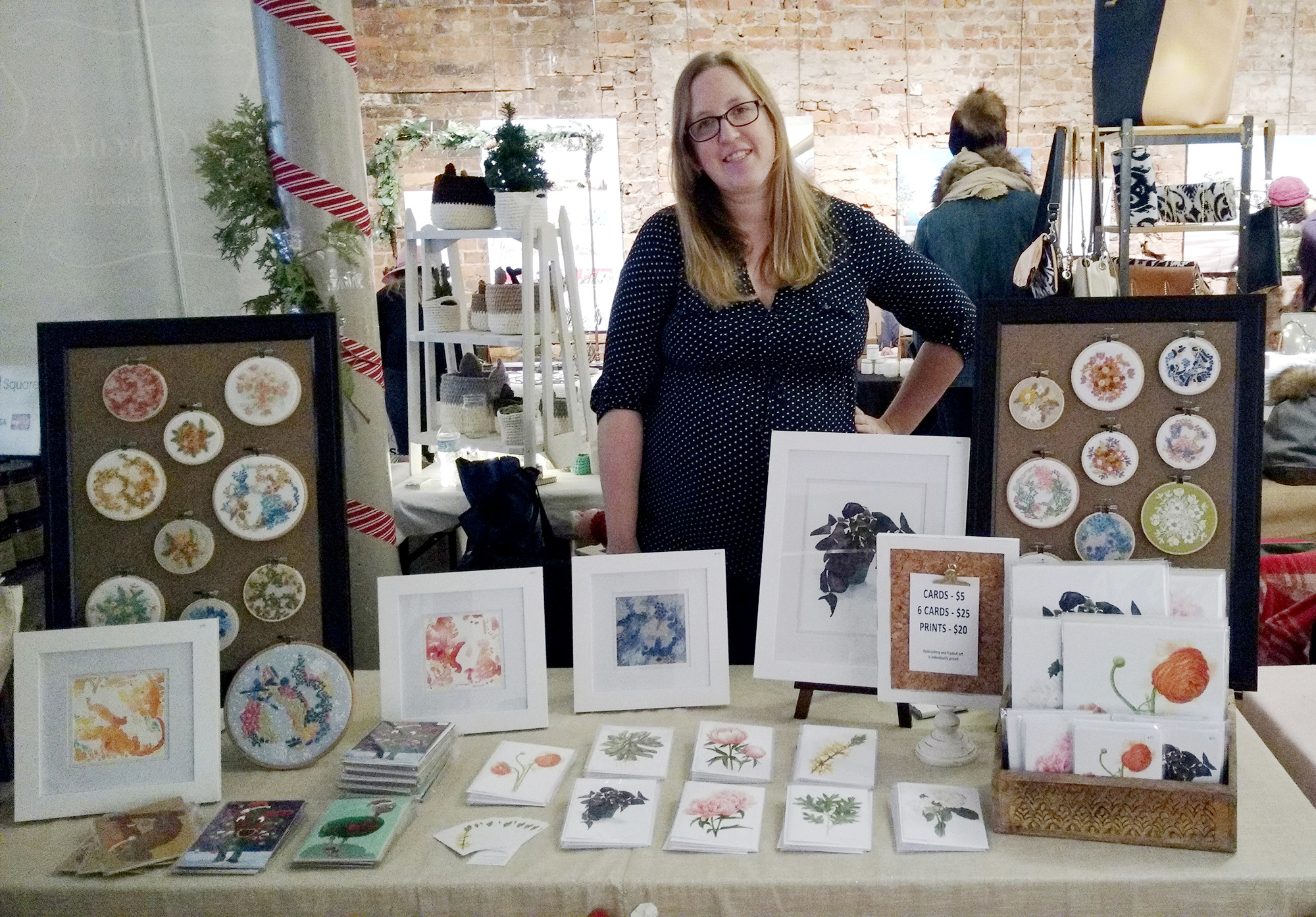 Amanda Farquharson standing behind her table at 'Called to Create' Handmade Market in December 2017