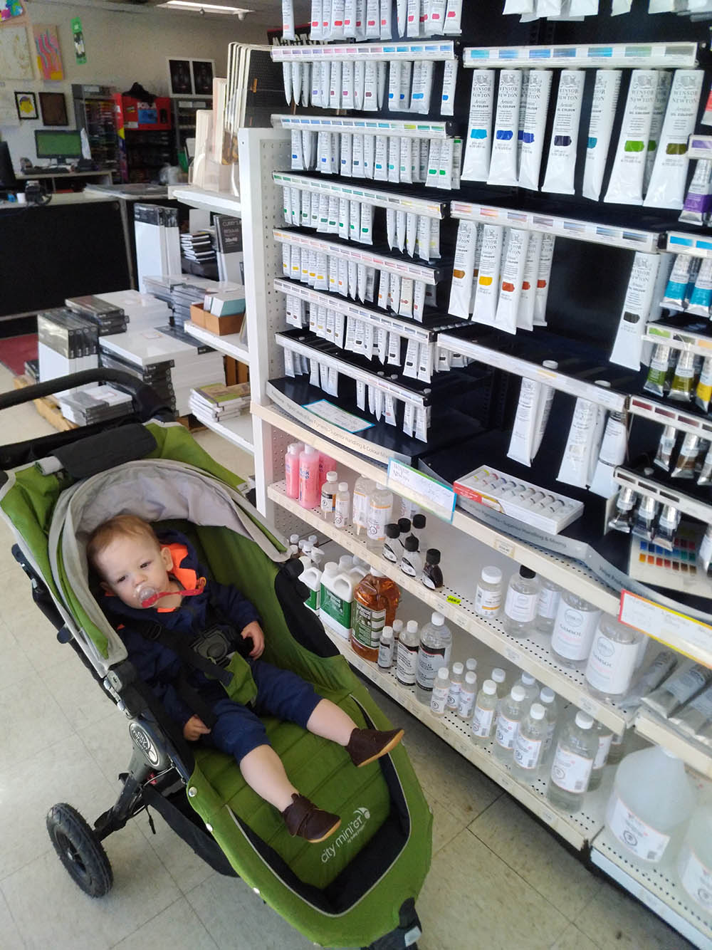 Why sit and be tired when you could be shopping for art supplies? OR if you are a baby you can do both at the same time!