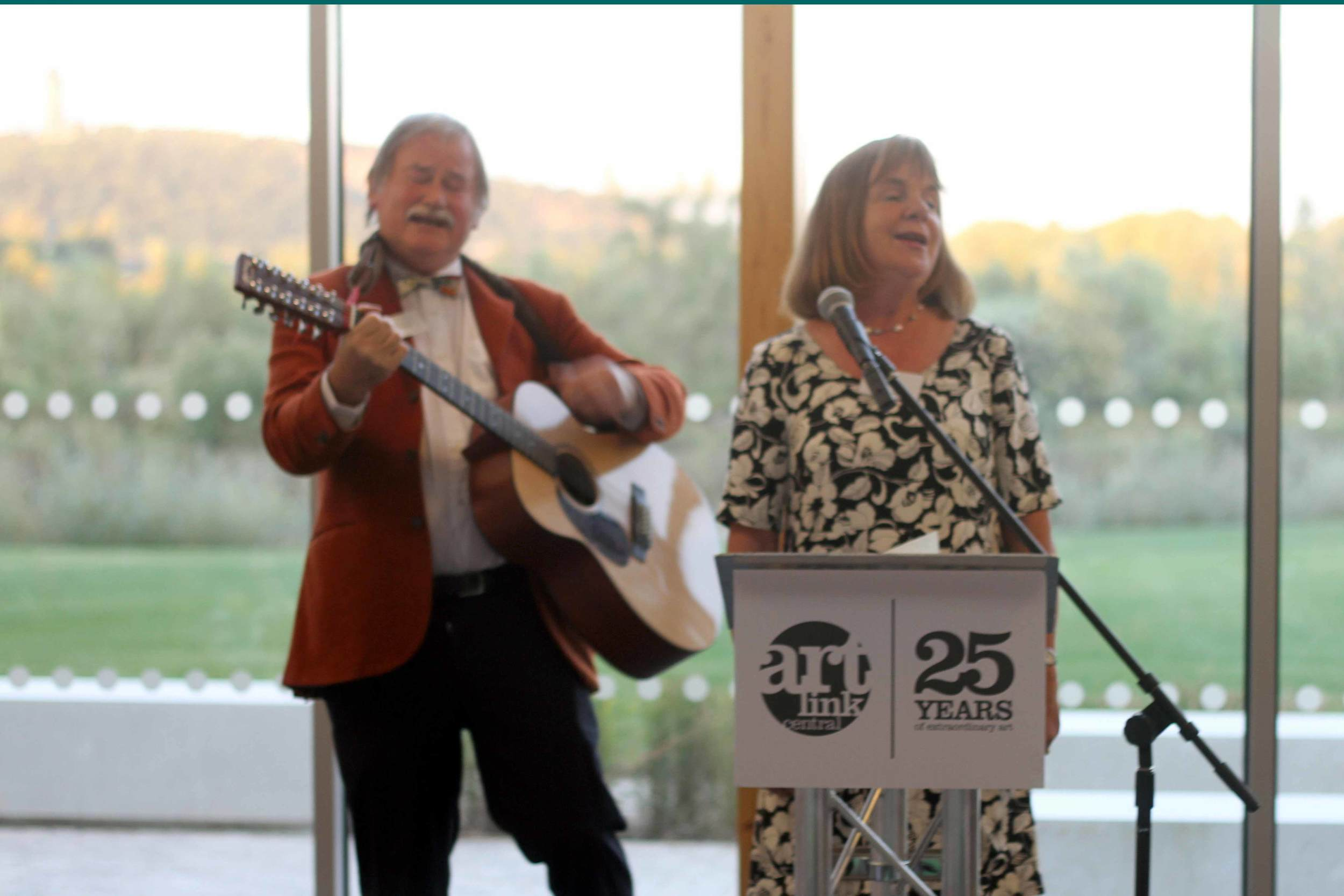 Malcolm Donaldson accompanies our Patron, Julia Donaldson in her rendition of 'Queen of the Volunteers' celebrating twenty years of dedication by our own Carol Seymour