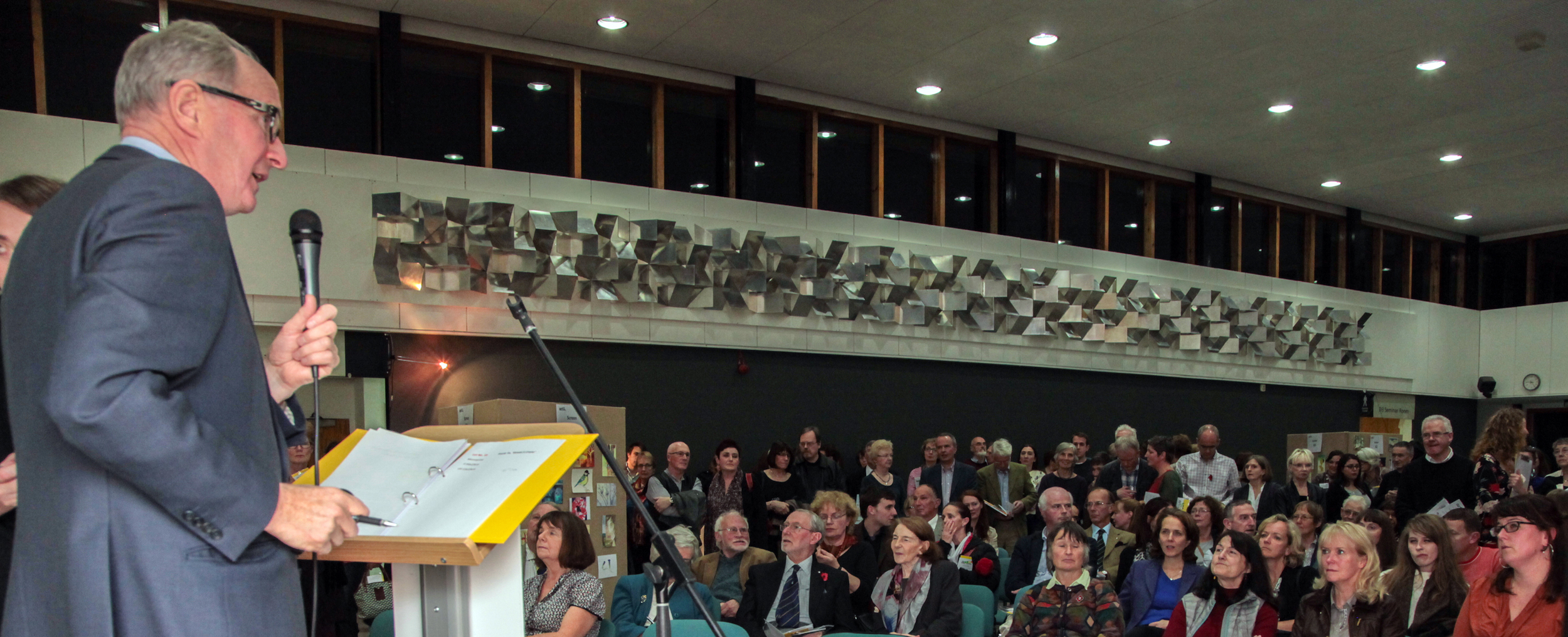 Auctioneer David Leggat gets the crowds attention for the opening bid