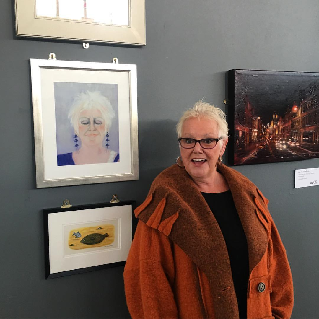 carol kidd with self portrait and work by axel scheffler