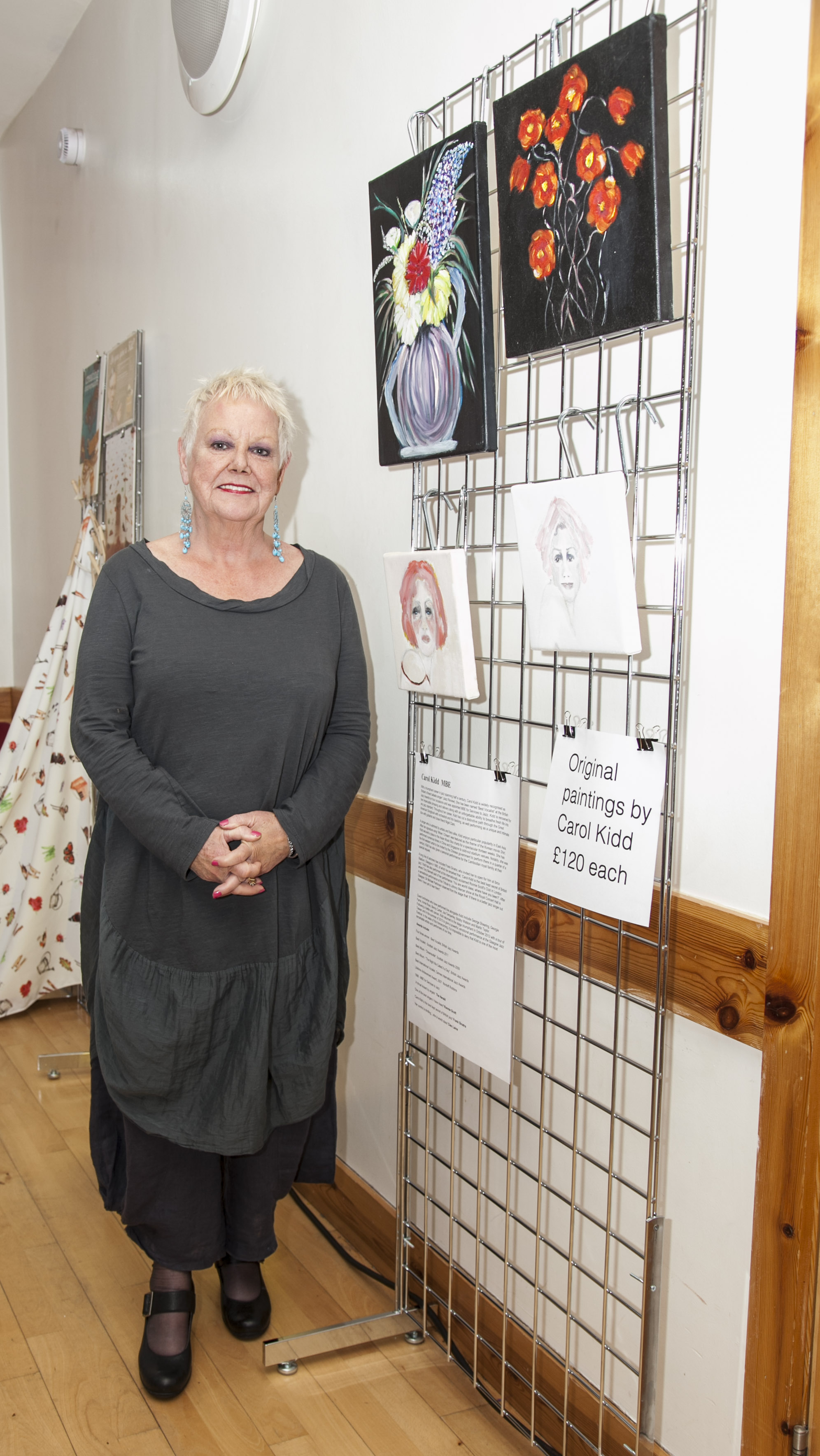Carol Kidd with some of her artworks for sale.jpg