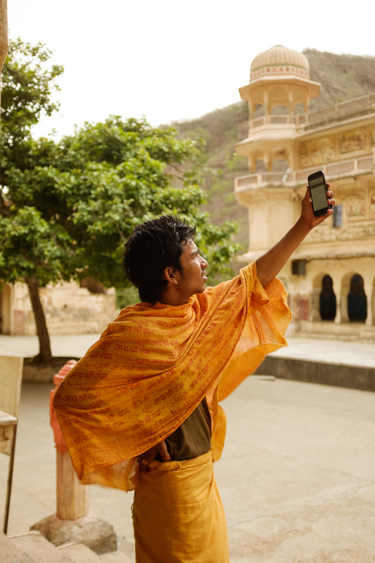 Vijay, searching for signal. / Jaipur, India / May 2014