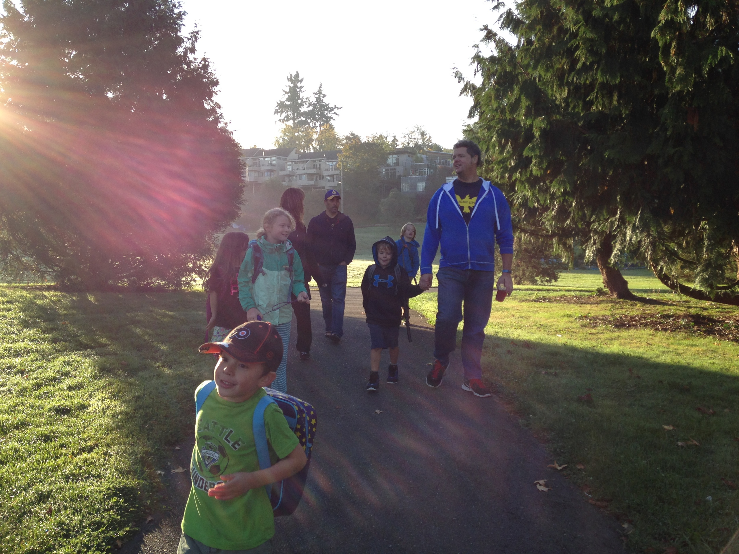 A few families take in some bright fall sunshine on a 15-minute walk to from Empire Espresso to Hawthorne.