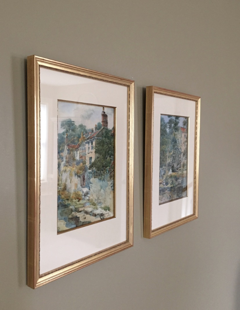 Now framed, they hang on the wall behind the dining room table.