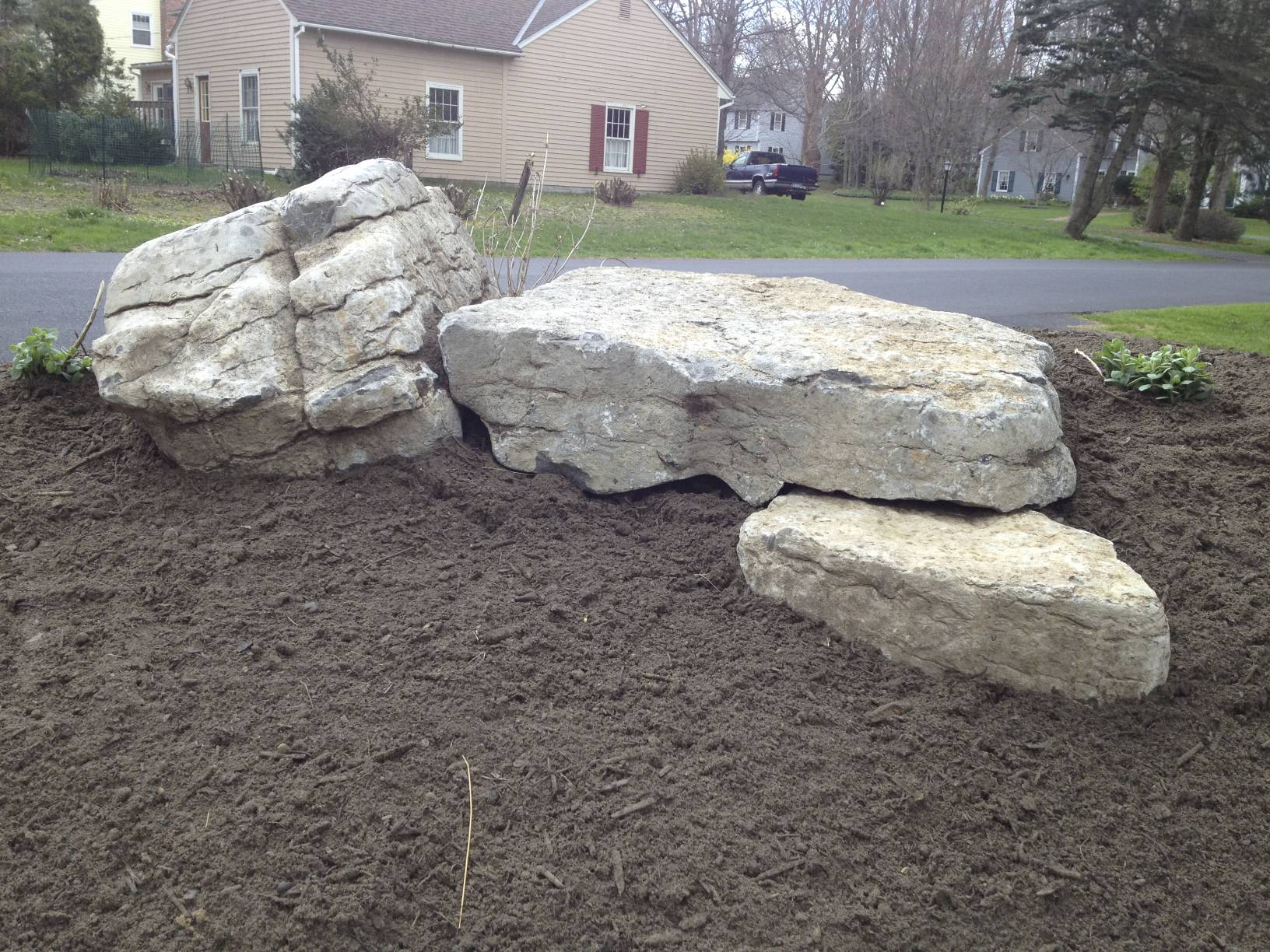 The stones not only provide contrast with the plantings, they also allow access to the upper part of the berm.