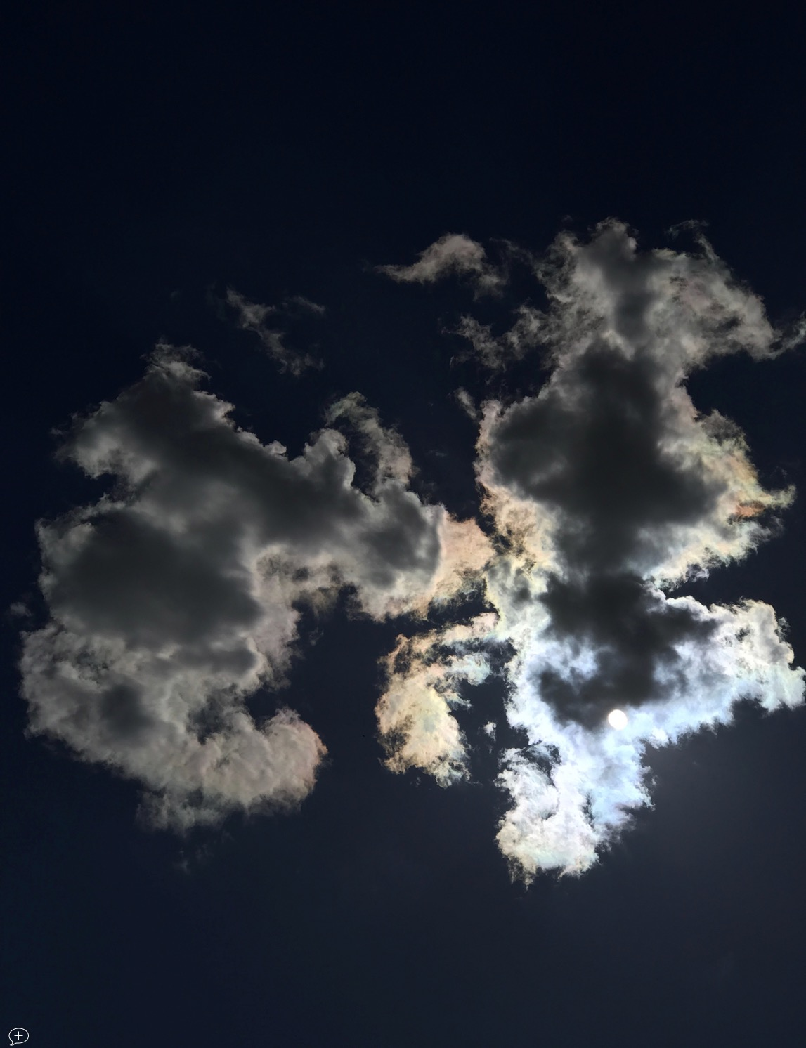 "17. S un Behind Clouds , iPhone 7+, 2017. Saratoga Springs, NY. (Canvas Photo, 16"" x 20,""). As you probably have already gathered, I have a fascination for clouds—made legitimate through a membership of the British Cloud Appreciation Society. This one was shot from the patio at the back of my house.  ©2017 Sean Walmsley"
