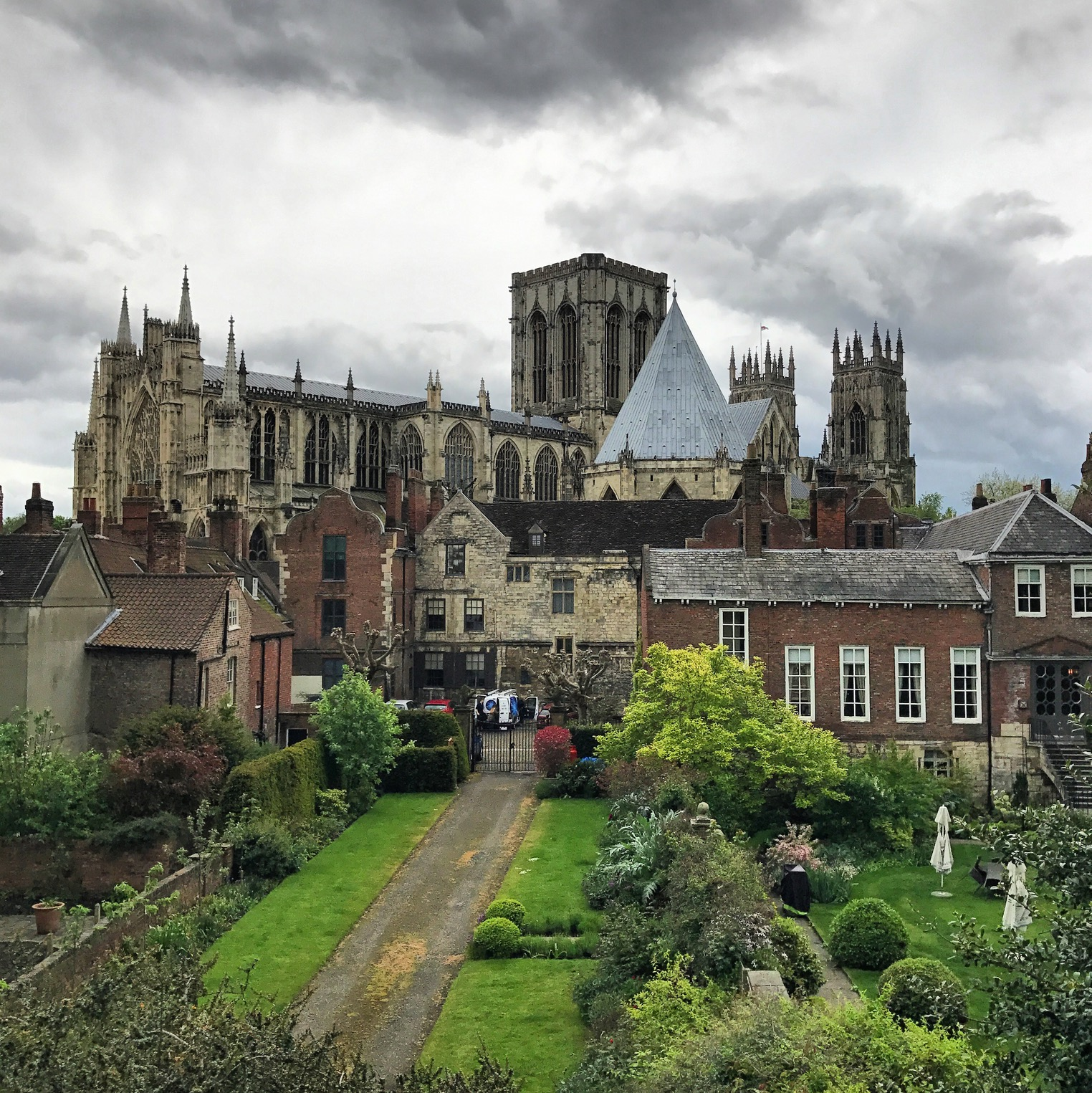 """From Wikipedia: The Cathedral and Metropolitical Church of Saint Peter in York, commonly known as York Minster, is the  cathedral  of  York ,  England , and is one of the largest of its kind in Northern Europe. The minster is the seat of the  Archbishop of York , the third-highest office of the  Church of England  (after the monarch as  Supreme Governor  and the  Archbishop of Canterbury ), and is the  mother church  for the  Diocese of York  and the  Province of York . [3]  It is run by a dean and chapter, under the  Dean of York . The title """" minster """" is attributed to churches established in the Anglo-Saxon period as missionary teaching churches, and serves now as an honorific title. [4]  Services in the minster are sometimes regarded as on the  High Church  or  Anglo-Catholic  end of the Anglican continuum. [5]   The minster has a very wide  Decorated Gothic  nave and  chapter house , a  Perpendicular Gothic  quire and east end and  Early English  North and South  transepts . The  nave  contains the West Window, constructed in 1338, and over the Lady Chapel in the east end is the Great East Window (finished in 1408), the largest expanse of medieval stained glass in the world. In the north transept is the Five Sisters Window, each  lancet being over 53 feet (16.3 m) high. [6]  The south transept contains a  rose window , while the West Window contains a heart-shaped design colloquially known as The Heart of Yorkshire."""
