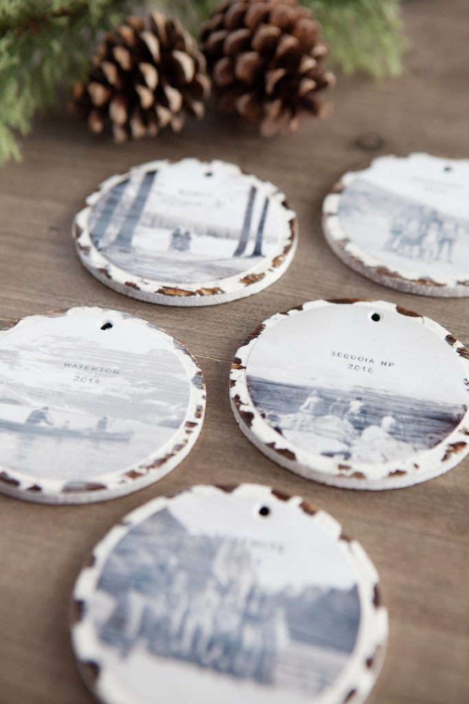 - Purchase distressed round disc ornaments. If you can't find these at your local Michaels craft store, I did find these wood ornaments that you could paint white and distress yourself.