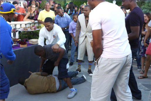 Kevin Hart being beaten up by an eight-year-old boy while Nelly tires to intervene and Nick Cannon looks on. Viva BET!