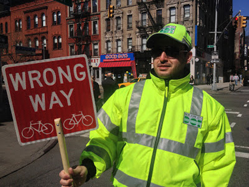 As seen in the East Village, this DOT worker is like school crossing guards, except for adults on bikes who needs to be schooled.