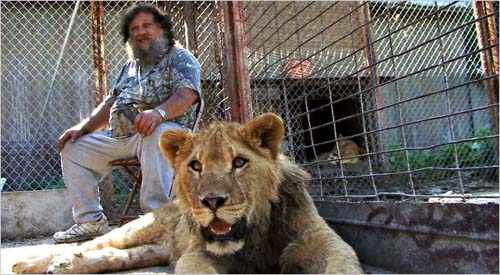 "Terry Brumfield and his ""pet,"" Lambert the lion."