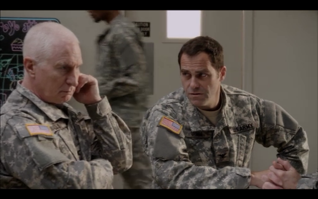 Andy Buckley (right) as the commanding officer of a strip-mall-based contingent of remote drone pilots.